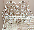 old 2 seater iron bench