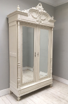 french antique Henri II style armoire with basket of Flowers