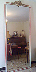 very tall crested french antique mirror
