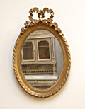 ANTIQUE OVAL MIROR