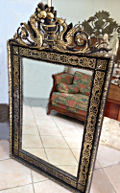 french antique black and gilded crested mirror
